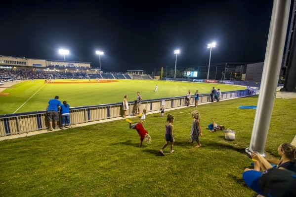 Kids play in a grass area behind the outfield while the Biloxi Shuckers take on the Pensacola Blue Wahoos at MGM Park in Biloxi, Miss. on Wednesday, Aug. 12, 2015. (Joshua Dahl/Las Vegas Review-Jo ...