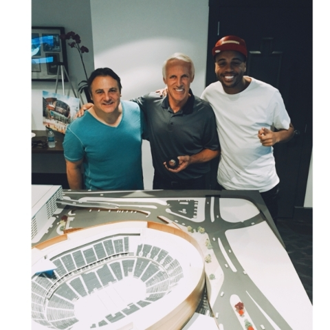 "Former New York Islanders great Mike Bossy holds the puck that scored the 50th goal in 50 games in the 1981 season, as he poses with Gavin Maloof, left, and Julian ""J.J."" Jones, who help ..."