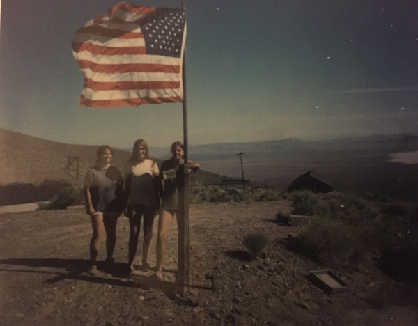Barbara Sheahan Manning, from left, Mary Sheahan Fuller and Martha Sheahan stand near a flag near Groom Mine in the 1970s. Courtesy, Sheahan family