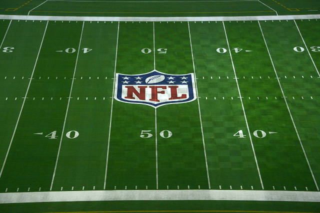 Jan 23, 2015; Glendale, AZ, USA; General view of NFL shield logo at midfield of University of Phoenix Stadium in advance of Super Bowl XLIX between the Seattle Seahawks and the New England Patriot ...