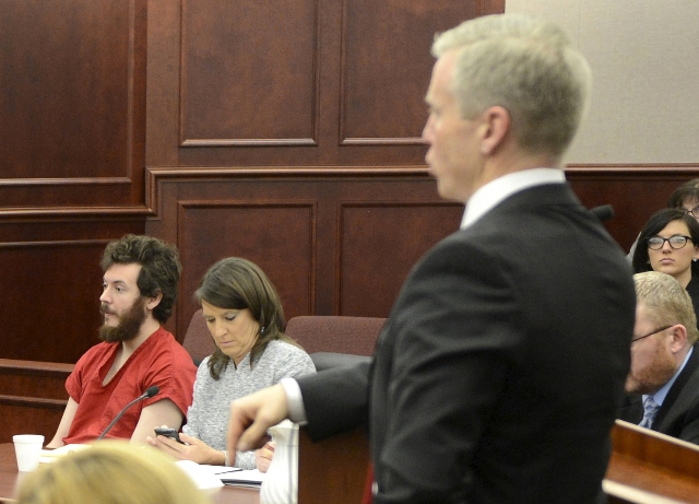Accused Aurora theater gunman James Holmes (L)  listens to Arapahoe County District Attorney George Brauchler (R) at his arraignment in Centennial, Colorado in a March 12, 2013 file photo. (R.J. S ...