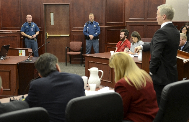 Accused Aurora theater gunman James Holmes (3rd from R) listens to Arapahoe County District Attorney George Brauchler (R) at his arraignment in Centennial, Colorado in this March 12, 2013 file pho ...