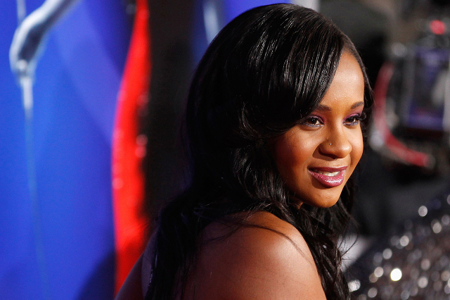 """Bobbi Kristina Brown, daughter of the late singer Whitney Houston, poses at the premiere of """"Sparkle"""" in Hollywood, California in this file photo from August 16, 2012. Brown, aged 22,  d ..."""