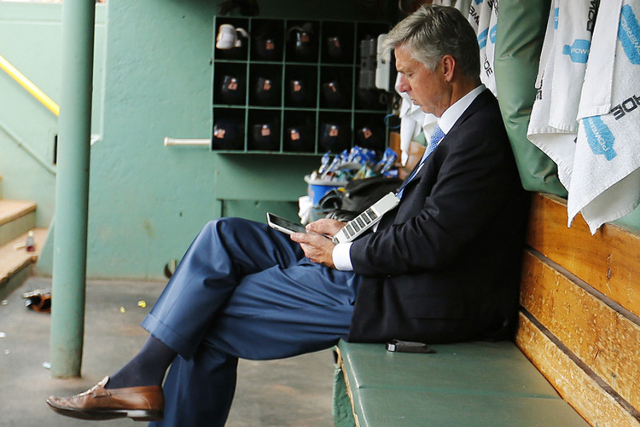 Jul 26, 2015; Boston, MA, USA; Detroit Tigers President, CEO and General Manager Dave Dombrowski works in the dugout before their game against the Boston Red Sox  at Fenway Park. Mandatory Credit: ...