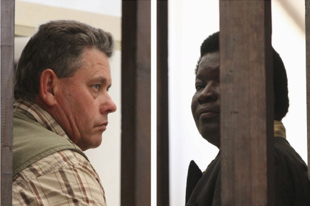A combination photo shows Zimbabwean safari operator Honest Ndlovu (R) and fellow countryman and hunter Theo Bronkhorst waiting to appear in Hwange magistrates court, July 29, 2015.  (Reuters/Phil ...