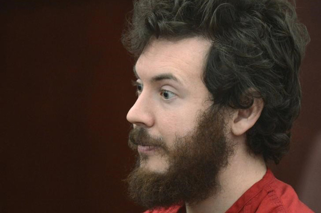 Accused Aurora theater gunman James Holmes listens during his arraignment in Centennial, Colorado March 12, 2013. (R.J. Sangosti/Pool/Reuters)
