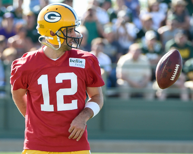 Jul 30, 2015; Green Bay, WI, USA;  Green Bay Packers quarterback Aaron Rodgers flips the ball from behind his back during training camp at Ray Nitschke Field. (Benny Sieu/USA Today Sports)