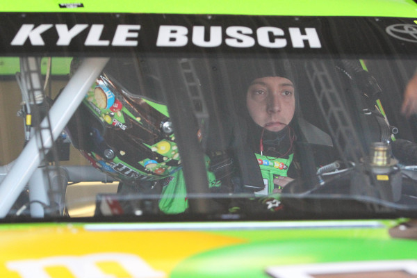 Kyle Busch sits in the Joe Gibbs Racing No. 18 Toyota during Sprint Cup practice Friday at Pocono Raceway in Long Pond, Pa. Busch won the pole, but his bid for a fourth straight victory in the ser ...