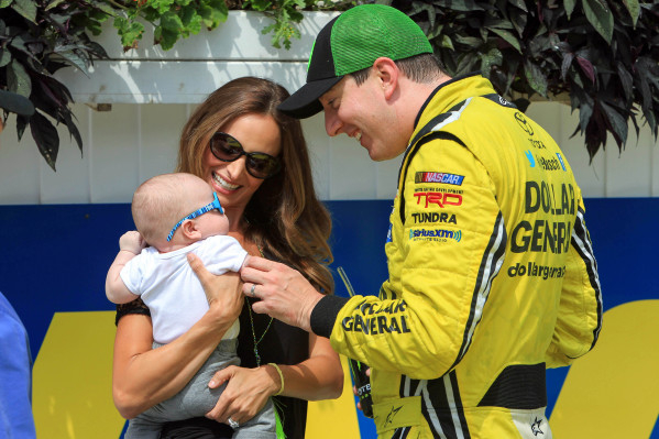 Kyle Busch celebrates in Victory Lane with wife Samantha and infant son Brexton after winning the NASCAR Camping World Truck Series race Saturday at Pocono Raceway in Long Pond, Pa. MATTHEW O&lsqu ...