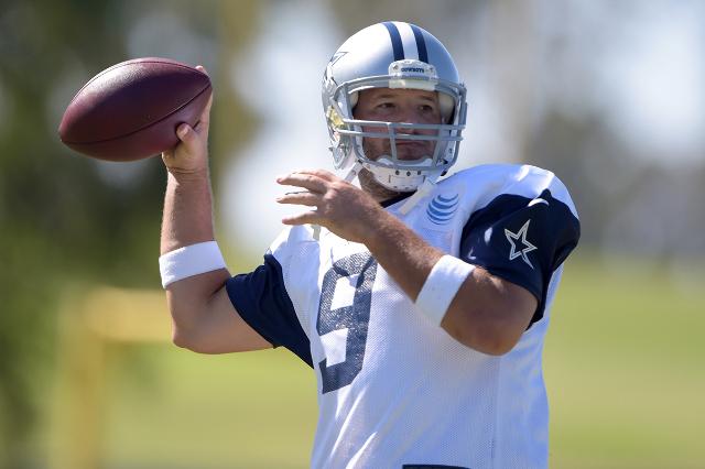Aug 1, 2015; Oxnard, CA, USA; Dallas Cowboys quarterback Tony Romo (9) throws a pass at training camp at River Ridge Fields. (Kirby Lee/USA Today Sports)