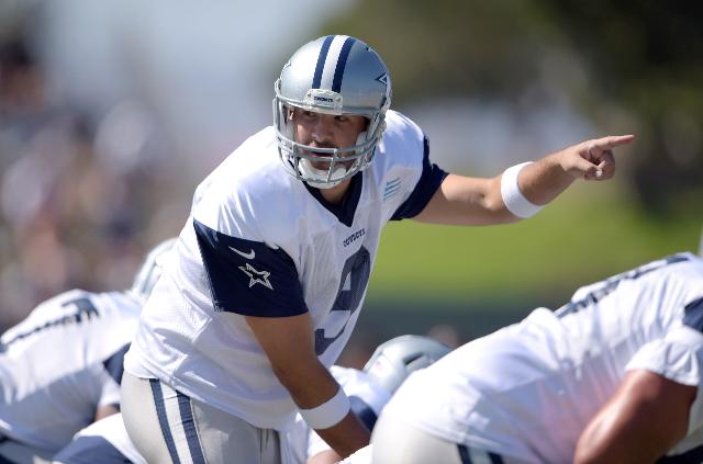 Aug 1, 2015; Oxnard, CA, USA; Dallas Cowboys quarterback Tony Romo (9) takes the snap at training camp at River Ridge Fields. (Kirby Lee/USA Today Sports)