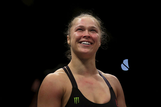 Ronda Rousey (R) of U.S celebrates after defeating Bethe Correia of Brazil during their Ultimate Fighting Championship (UFC) match, a professional mixed martial arts (MMA) competition in Rio de Ja ...