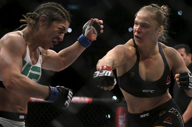 Ronda Rousey (R) of U.S fights with Bethe Correia of Brazil during their Ultimate Fighting Championship (UFC) match, a professional mixed martial arts (MMA) competition in Rio de Janeiro, Brazil A ...