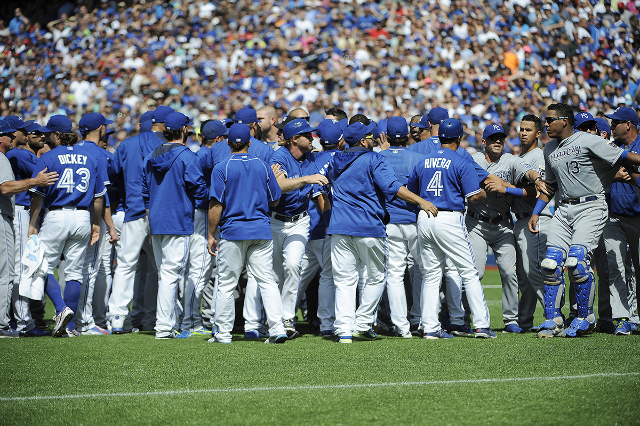 Aug 2, 2015; Toronto, Ontario, CAN; Toronto Blue Jays and Kansas City Royals players confrontation after relief pitcher Aaron Sanchez (41) pitches and hits Kansas City Royals short stop Alcides Es ...
