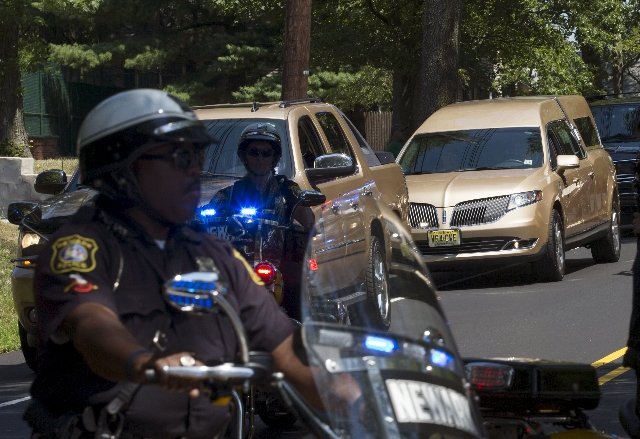 A hearse carrying the remains of Bobbi Kristina Brown arrives with a police escort for a burial service at the Fairview Cemetery in Westfield, New Jersey, August 3, 2015. Brown, the only child of  ...