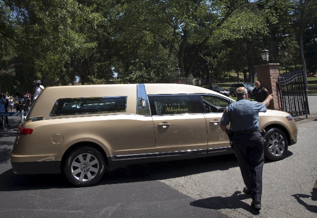 A hearse carrying the remains of Bobbi Kristina Brown arrives for a burial service at the Fairview Cemetery in Westfield, New Jersey, August 3, 2015. (Mike Segar/Reuters)