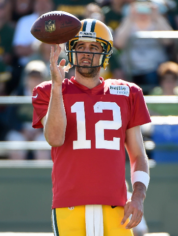 Aug 3, 2015; Green Bay, WI, USA; Green Bay Packers quarterback Aaron Rodgers plays with the football during training camp at Ray Nitschke Field. (Benny Sieu/USA Today Sports)
