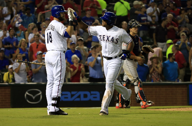 Aug 3, 2015; Arlington, TX, USA; Texas Rangers third baseman Adrian Beltre (29) celebrates with first baseman Mitch Moreland (18) after hitting a home run to complete the cycle during the fifth in ...