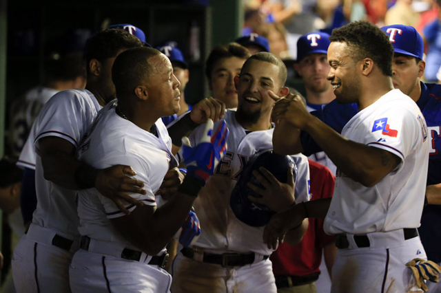 Aug 3, 2015; Arlington, TX, USA; Texas Rangers third baseman Adrian Beltre (29) celebrates with teammates after hitting a home run to complete the cycle during the fifth inning against the Houston ...