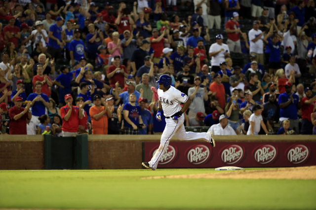 Aug 3, 2015; Arlington, TX, USA; Texas Rangers third baseman Adrian Beltre (29) runs the bases after hitting a home run to complete the cycle during the fifth inning against the Houston Astros at  ...