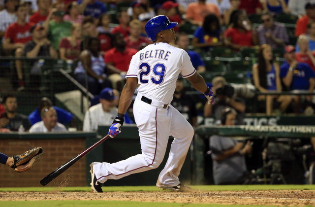 Aug 3, 2015; Arlington, TX, USA; Texas Rangers third baseman Adrian Beltre (29) hits a home run to complete the cycle during the fifth inning against the Houston Astros at Globe Life Park in Arlin ...