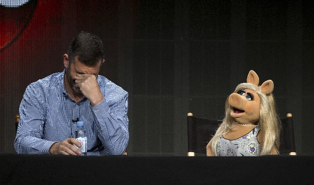 "Writer and executive producer Bob Kushell and Muppets character Miss Piggy attend a panel for the Disney-ABC television series ""The Muppets"" during the Television Critics Association Cab ..."