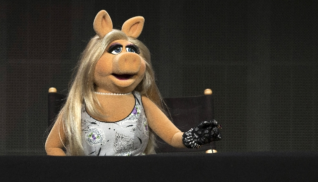 "The Muppets character Miss Piggy speaks at a panel for the Disney-ABC television series ""The Muppets"" during the Television Critics Association Cable Summer Press Tour in Beverly Hills,  ..."
