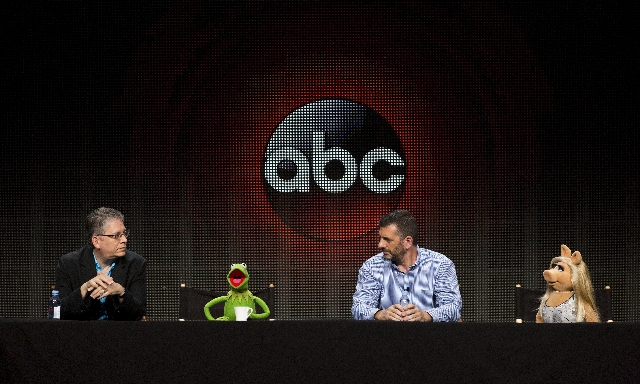 "Writers and executive producers Bill Prady (L) and Bob Kushell and Muppet characters Kermit the Frog and Miss Piggy attend a panel for the Disney-ABC television series ""The Muppets"" duri ..."