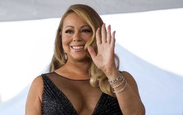 Recording artist Mariah Carey attends the ceremony for the unveiling of her star on the Hollywood Walk of Fame in Los Angeles, California August 5, 2015.  (Mario Anzuoni/Reuters)