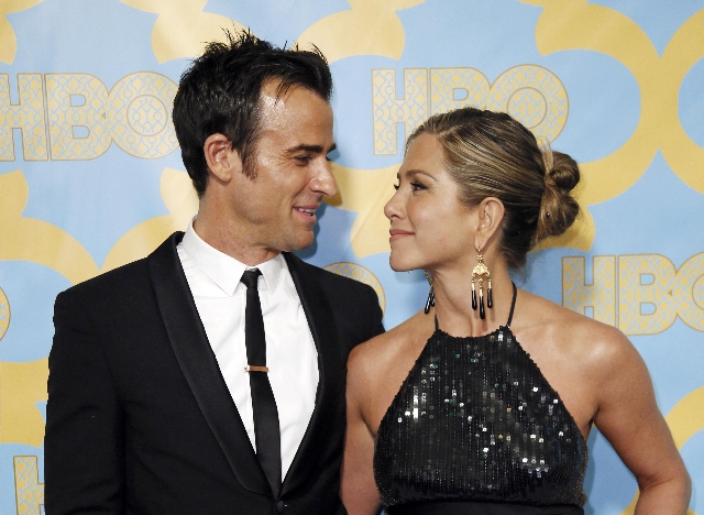 Actors Jennifer Aniston and Justin Theroux pose at the HBO after-party after the 72nd annual Golden Globe Awards in Beverly Hills, California, in this file photo taken January 11, 2015. Former &qu ...