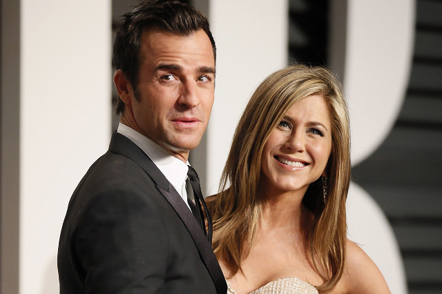 Actress Jennifer Aniston and fiance Justin Theroux arrive at the 2015 Vanity Fair Oscar Party in Beverly Hills, California, in this file photo taken February 22, 2015. (Danny Moloshok/Files/Reuters)