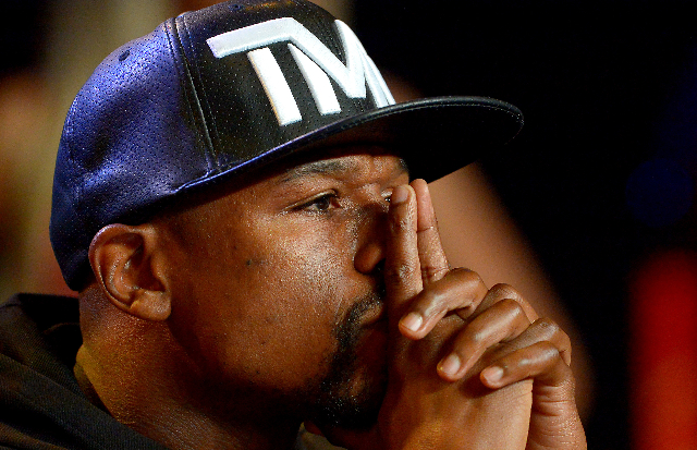 Aug 6, 2015; Los Angeles, CA, USA; Floyd Mayweather, Jr. listens during a press conference to announce the upcoming fight on September 12, 2015 at J.W. Marriott LA Live. (Jayne Kamin-Oncea/USA Tod ...