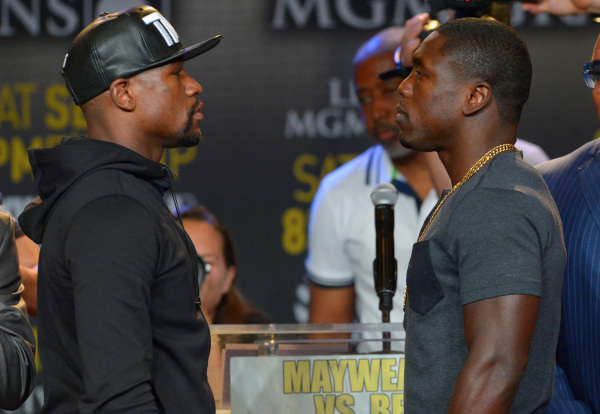 Aug 6, 2015; Los Angeles, CA, USA; Floyd Mayweather, Jr. and Andre Berto face off during a press conference to announce the upcoming fight on September 12, 2015 at J.W. Marriott LA Live. Mandatory ...