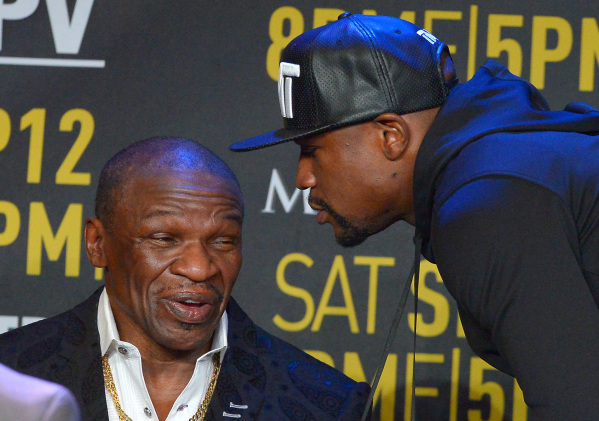 Welterweight champion Floyd Mayweather Jr., right, speaks to his father Floyd Mayweather Sr. on Thursday in Los Angeles at a news conference to promote Floyd Jr.'s fight against Andre Berto  ...
