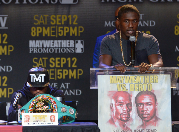 Challenger Andre Berto speaks and welterweight champion Floyd Mayweather Jr. listens during a news conference Thursday in Los Angeles to promote their title fight Sept. 12 at the MGM Grand Garden. ...