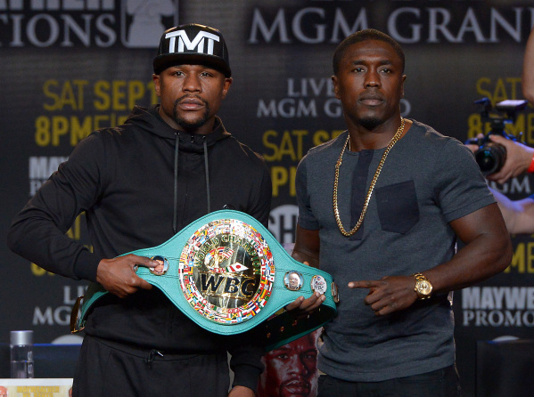 Undefeated champion Floyd Mayweather Jr., left, allows Andre Berto to touch the welterweight belt that will be at stake during their Sept. 12 fight at the MGM Grand Garden. The fighters were in Lo ...