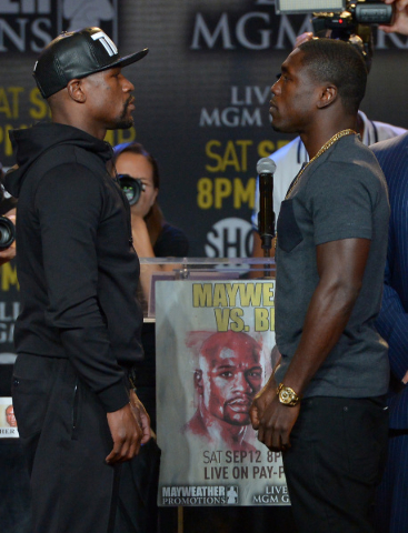 Undefeated champion Floyd Mayweather Jr., left, faces off with Andre Berto on Thursday in Los Angeles where the welterweights began promotion for their Sept. 12 title fight at the MGM Grand Garden ...