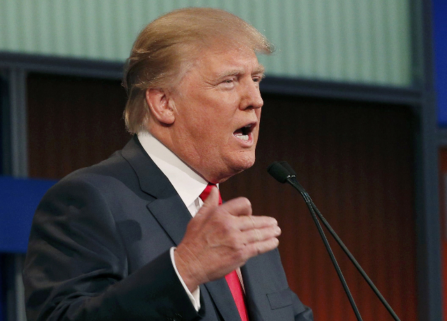 Republican 2016 presidential candidate businessman Donald Trump answers a question at the first official Republican presidential candidates debate of the 2016 U.S. presidential campaign in Clevela ...