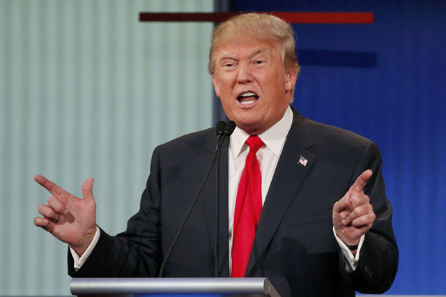 Republican 2016 U.S. presidential candidate businessman Donald Trump answers a question at the first official Republican presidential candidates debate of the 2016 U.S. presidential campaign in Cl ...