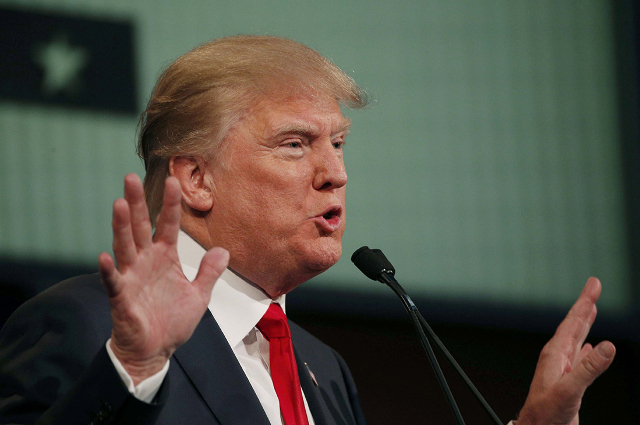 Republican 2016 presidential candidate and businessman Donald Trump answers a question at the first official Republican presidential candidates debate of the 2016 U.S. presidential campaign in Cle ...