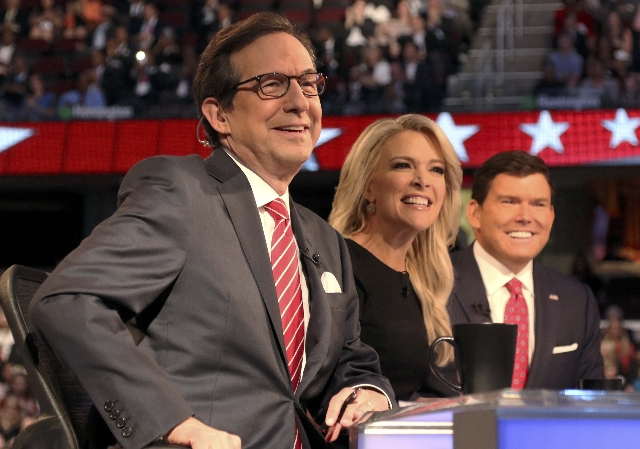 Fox News Channel debate moderators (L-R), Chris Wallace, Megyn Kelly and Brett Baier, start the first official Republican presidential candidates debate of the 2016 U.S. presidential campaign in C ...