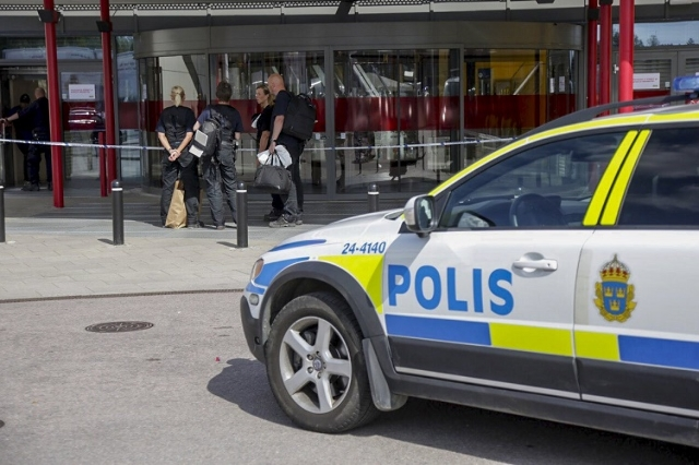 Police officers are seen in front of an Ikea store in Vasteras, central Sweden, August 10, 2015. Two people were killed and one seriously injured in a knife attack at an IKEA store in the city of  ...