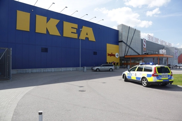 A police car is seen in front of an Ikea store in Vasteras, central Sweden, August 10, 2015. Two people were killed and one seriously injured in a knife attack at an IKEA store in the city of Vest ...