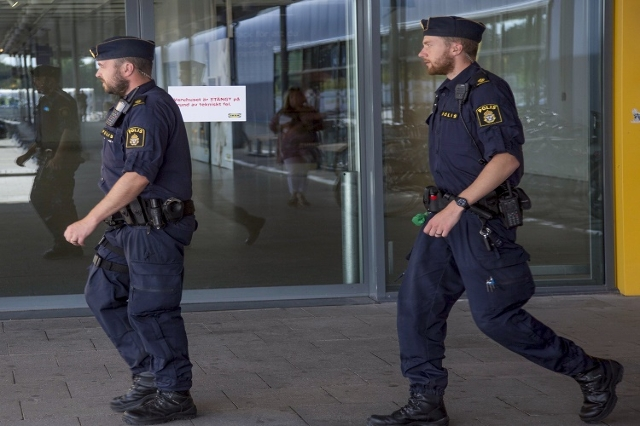 Police officers walk outside the Ikea store where a knife attack took place in Vasteras, Sweden August 10, 2015. A man and a woman were killed in the knife attack at the IKEA store in the Swedish  ...