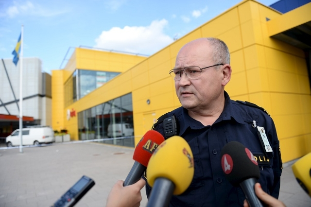 Police spokesman Per Stromback speaks to the media outside the Ikea store where a knife attack took place in Vasteras, Sweden August 10, 2015. A man and a woman were killed in the knife attack at  ...