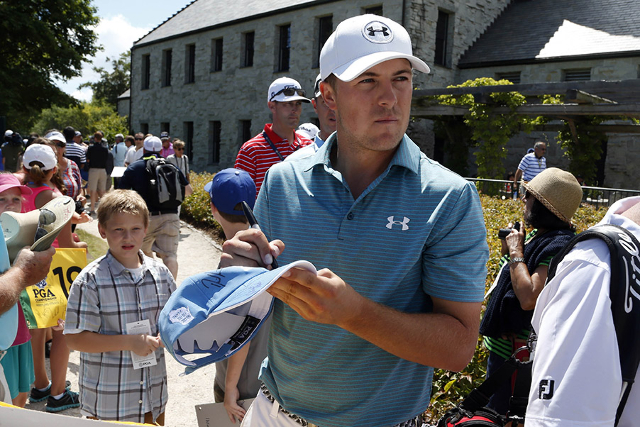 Jordan Spieth signs autographs during a practice round for the 2015 PGA Championship golf tournament at Whistling Straits -The Straits Course. (Brian Spurlock/USA TODAY Sports)