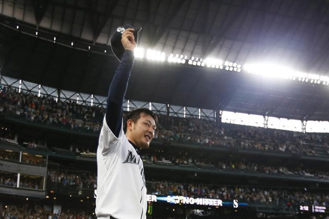 Seattle Mariners pitcher Hisashi Iwakuma (18) tips his cap to the fans following the final out of his no-hit, 3-0 victory against the Baltimore Orioles at Safeco Field.   (Joe Nicholson/USA TODAY  ...