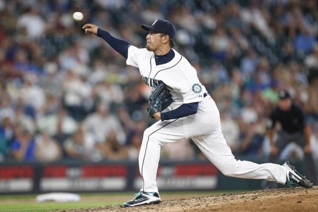 Seattle Mariners pitcher Hisashi Iwakuma (18) throws against the Baltimore Orioles during the eighth inning at Safeco Field.  (Joe Nicholson/USA TODAY Sports)