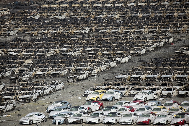 Burnt cars are seen near the site of the explosions at the Binhai new district, Tianjin, August 13, 2015. REUTERS/Damir Sagolj