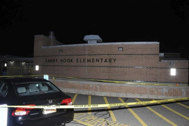 The car driven by Adam Lanza is pictured at Sandy Hook Elementary School in Newtown, Connecticut, in this evidence photo released by the Connecticut State Police, December 27, 2013.  (Reuters/Conn ...